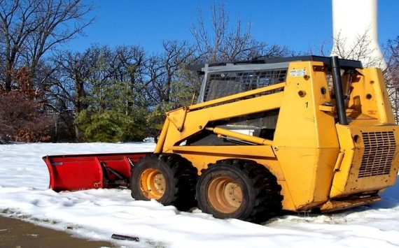 Carefully Using A Plow To Remove Snow In Pennsylvania From Roadways